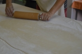 The dough has to be rolled out evenly to ensure the right shape of the strudel.