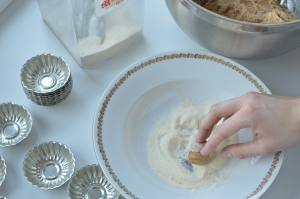 1. Take a little dough in between your fingers and form a small ball. Roll it in the flour to prevent sticking.